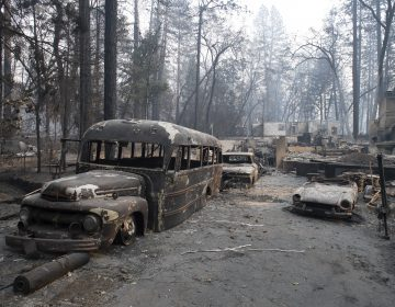 Burnt vehicles are seen in front of a destroyed house in Paradise, California, United States on November 16, 2018. Camp Fire has burnt so far 142,000 acres and is at 45% contained by Cal Fire. The death toll from the wild fire climbed to 63 with 631 on missing list. (Yichuan Cao/Sipa USA)(Sipa via AP Images)