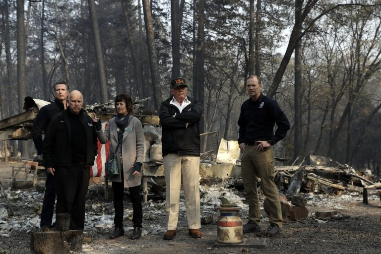 President Donald Trump talks with from left, Gov.-elect Gavin Newsom, California Gov. Jerry Brown, Paradise Mayor Jody Jones and FEMA Administrator Brock Longduring a visit to a neighborhood destroyed by the wildfires, Saturday, Nov. 17, 2018, in Paradise, Calif. (AP Photo/Evan Vucci)