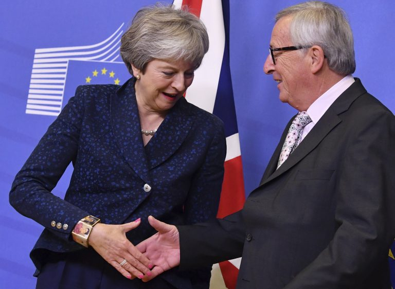 European Commission President Jean-Claude Juncker (right), shakes hands with British Prime Minister Theresa May prior to a meeting at EU headquarters in Brussels, Saturday, Nov. 24, 2018. British Prime Minister Theresa May is kicking off a big Brexit weekend by traveling to EU headquarters in Brussels for talks on Saturday with key leaders. (Geert Vanden Wijngaert/AP)