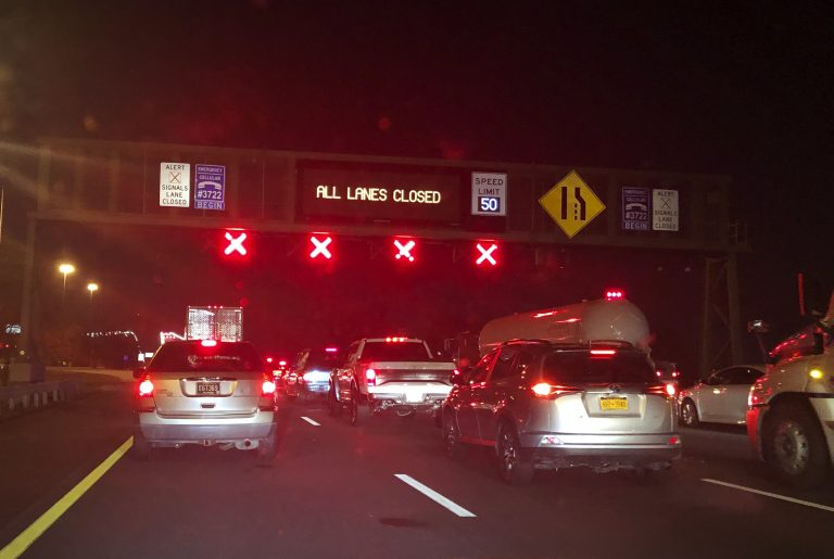This photo provided by Lashrecse Aird shows traffic jam and an electric message sign indicating,