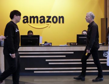 Employees walk through a lobby at Amazon's Seattle headquarters. (Elaine Thompson/AP Photo)