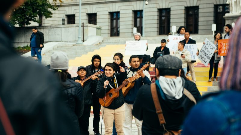 Yared Portillo sings with people gathered during the