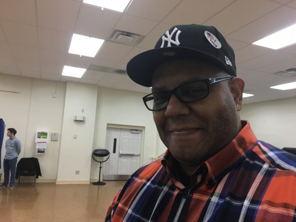 "Jose Young wants to vote so ""people from other countries stop laughing at us."" He didn't say who he voted for, but did say it was time to start unifying the country. (Taylor Allen/WHYY)"
