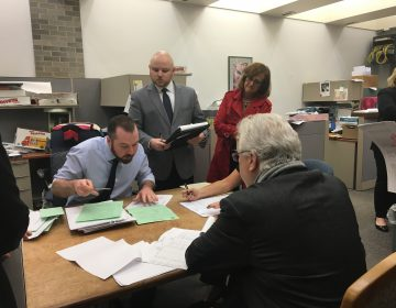 Election workers pore over Pennsylvania Senate's 6th District race in the Bucks County Courthouse. (Katie Meyer/WITF)