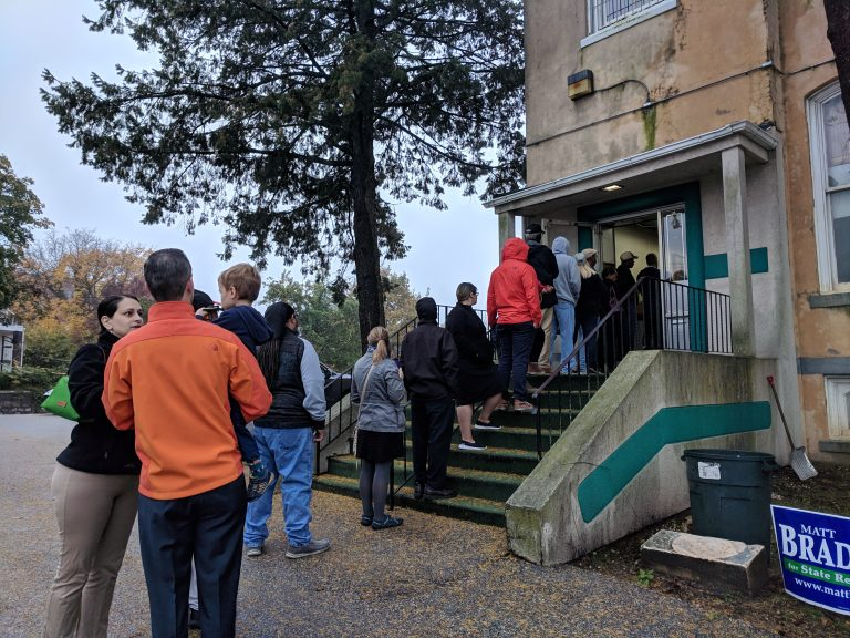 People wait in line to vote just after 7 a.m. at the Local 135 union hall on Sandy Street in Norristown, Montgomery County. (Katie Colaneri/WHYY)