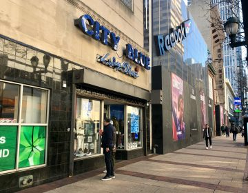 Shoppers gaze into the window of City Blue in Center City Philadelphia (Darryl C. Murphy/WHYY).