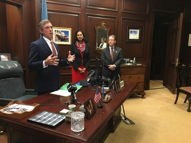Delaware Gov. John Carney talks about soaring health care costs before signing an executive order in his Wilmington office. (Mark Eichmann/WHYY)