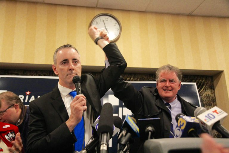 Brian Fitzpatrick celebrates his reelection with his brother, and former congressman, Mike Fitzpatrick. (Kimberly Paynter/WHYY)