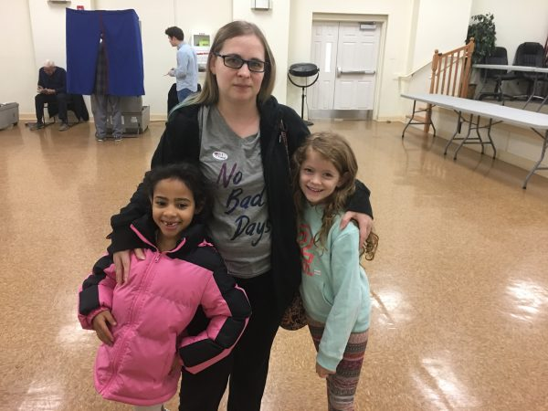 "Krystie Smoot brought her kids with her to vote today. She said she voted straight Democrat. ""I want to hopefully do some change."" (Taylor Allen/WHYY)"