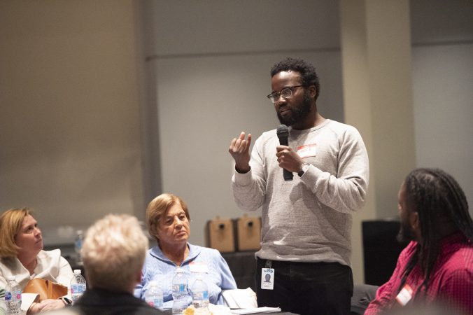 Daryl Murphy recaps his table's discussion topic at the conclusion of the event. (Jonathan Wilson for WHYY)