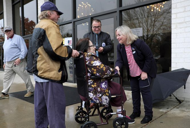 Susan Wild, Democratic candidate for Pennsylvania's new 7th Congressional District, greets voters on Election Day at Calvary Temple Church on Nov. 6, 2018, in Allentown, Pennsylvania. (Matt Smith for WHYY)