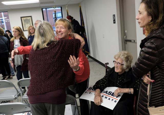 A supporter hugs Susan Wild, Democratic candidate for Pennsylvania's new 7th Congressional District, after a rally featuring Senator Bob Casey on Nov. 4, 2018, at local IBEW in Allentown, Pennsylvania. (Matt Smith for WHYY)