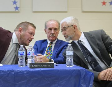 Tamaqua School board member Nicholas Boyle, left, and School Board President Larry Wittig, center, joined by Joe Egan, a representative of The Buckeye Firearm Foundation at a meeting in November. (Matt Smith for Keystone Crossroads)