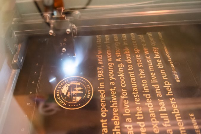 At Tiny WPA a laser cutter etches and trim street signs. (Jonathan Wilson for WHYY)