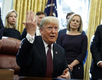 President Trump answers a reporter's question about the investigation of special counsel Robert Mueller during a bill signing ceremony in the Oval Office Friday. (Evan Vucci/AP)