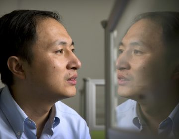 Genetics researcher He Jiankui said his lab considered ethical issues before deciding to proceed with DNA editing of human embryos to create twin girls with a modification to reduce their risk of HIV infection. Critics say the experiment was premature. (Mark Schiefelbein/AP)
