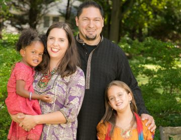 Tara and Alan Atchison with their two daughters.  (Image courtesy of the Atchison family)