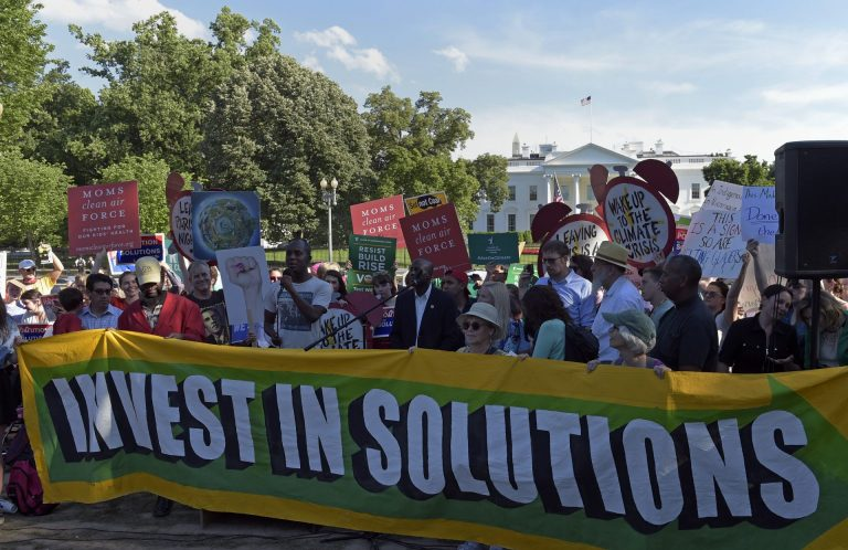 Activists gather outside the White House in Washington, Thursday, June 1, 2017, to protest President Donald Trump's decision to withdraw the Unites States from the Paris climate change accord. (Susan Walsh/AP Photo)