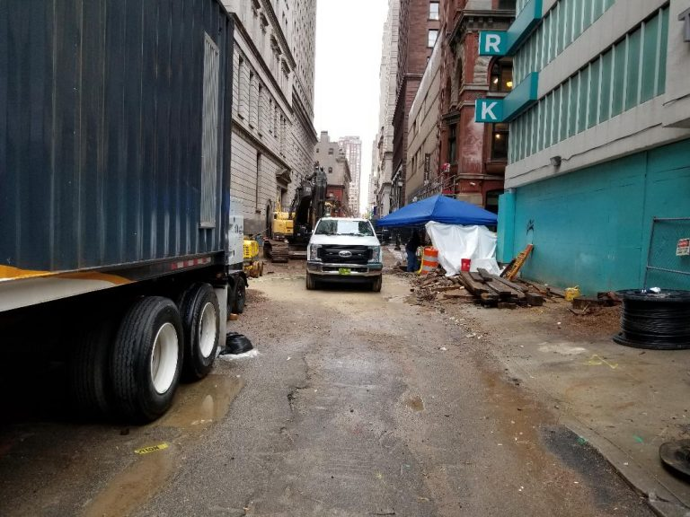Water main reconstruction continues on Sansom Street. (Tom MacDonald/ WHYY)
