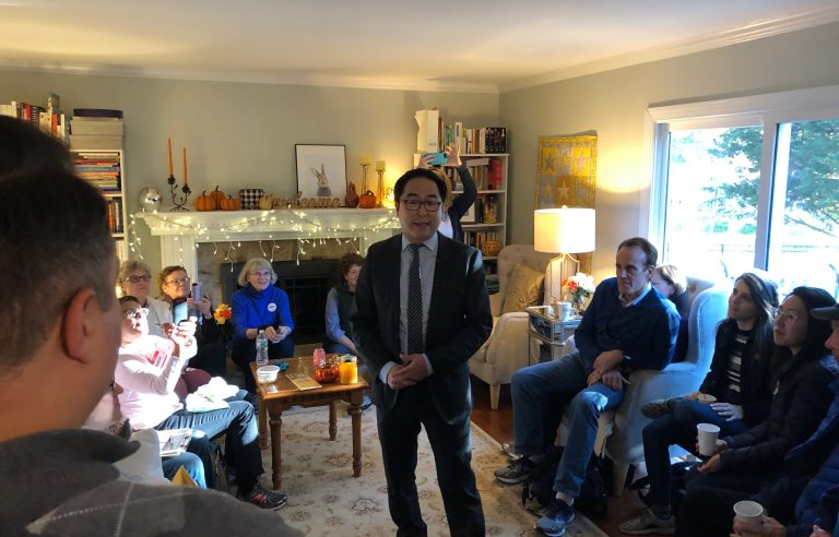 Democrat Andy Kim speaks to campaign volunteers at a home in Brick, New Jersey on Sunday, Nov. 4, 2018. (Joe Hernandez/WHYY)