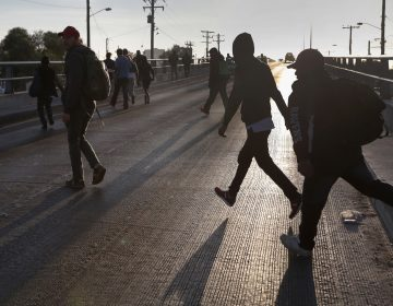 Members of the migrant caravan walk to make requests for political asylum at the U.S.-Mexico border last week in Tijuana, Mexico (John Moore/Getty Images)