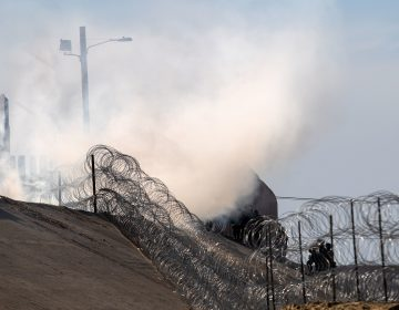 Tear gas thrown by the U.S. Border Patrol is seen near the El Chaparral/San Ysidro border crossing in Tijuana, Mexico, on Sunday