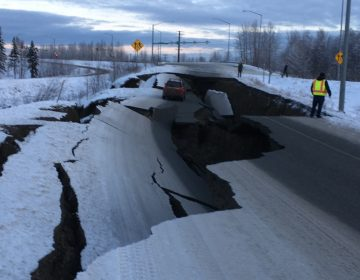 After an earthquake on Friday, a car is trapped in a crumbled section of off-ramp from Minnesota Drive, a major road in Anchorage, Alaska. (Nathaniel Herz/Alaska Public)