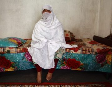 Mehnaz sits inside her home in Abbottabad, northern Pakistan. She has one son and six daughters. She has also had three abortions, fearing she would have more girls. (Diaa Hadid/NPR)