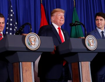 President Donald Trump signed the USMCA trade deal on Friday, alongside Canada's Prime Minister Justin Trudeau and Mexico's President Enrique Peña Nieto in Buenos Aires. (Kevin Lamarque/Reuters)