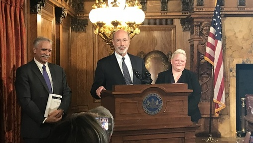 Governor Tom Wolf, flanked by outgoing budget secretary Randy Albright and his replacement, Jen Swails. (Katie Meyer/WITF)