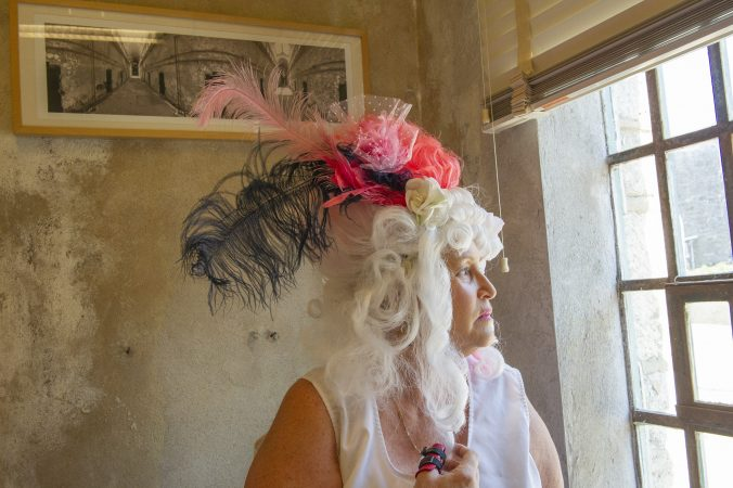 For nearly a quarter century, Terry McNally has played Marie Antoinette for Philadelphia's Bastille Day satirical celebration in the city's Fairmount section. She put her wig on for the last time July 14, 2018, after the Eastern State Penitentiary announced that it would no longer sponsor the event. (Jonathan Wilson for WHYY)