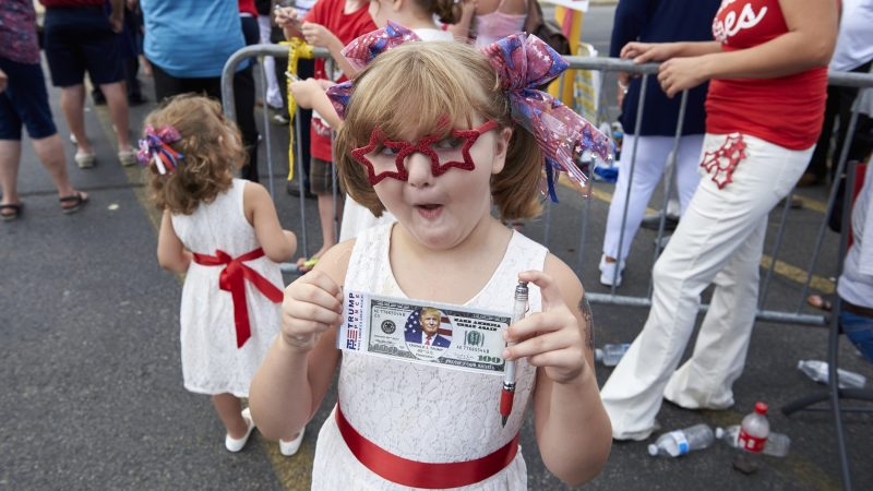 Savannah Corcoran, 6, from Plains, Pennsylvania, came to see President Donald Trump at the Make America Great Again rally in Wilkes-Barre on Aug. 2, 2018. She dressed in patriotic garb, which she found earlier that day at Joann Fabric. (Natalie Piserchio for WHYY)