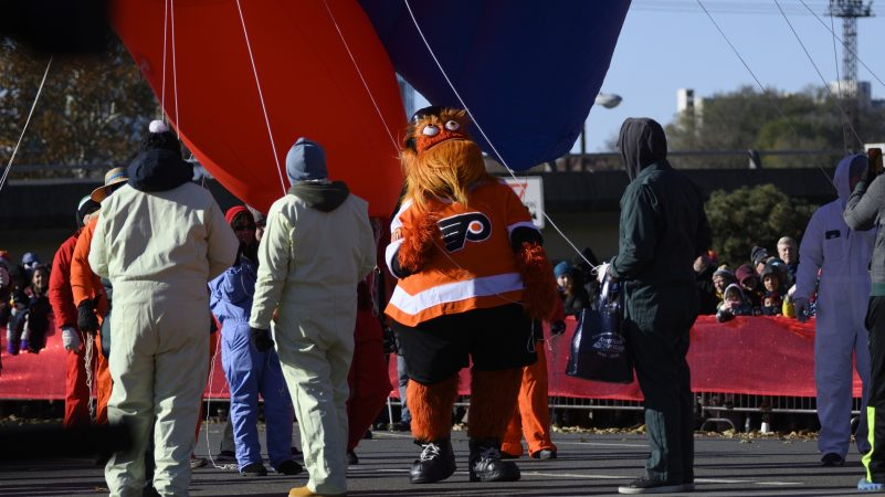 Flyers mascot Gritty helps balloon handlers during the 99th annual Thanksgiving Day Parade in Center City Philadelphia. (Bastiaan Slabbers for WHYY)