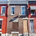 Philadelphia Police Detective Lawrence Greene bought 2931 Waterloo Street, center, in an auction of property seized by the District Attorney. The DA was empowered to take homes connected to alleged drug activity without a guilty verdict. The house is vacant today. (Kimberly Paynter/WHYY)