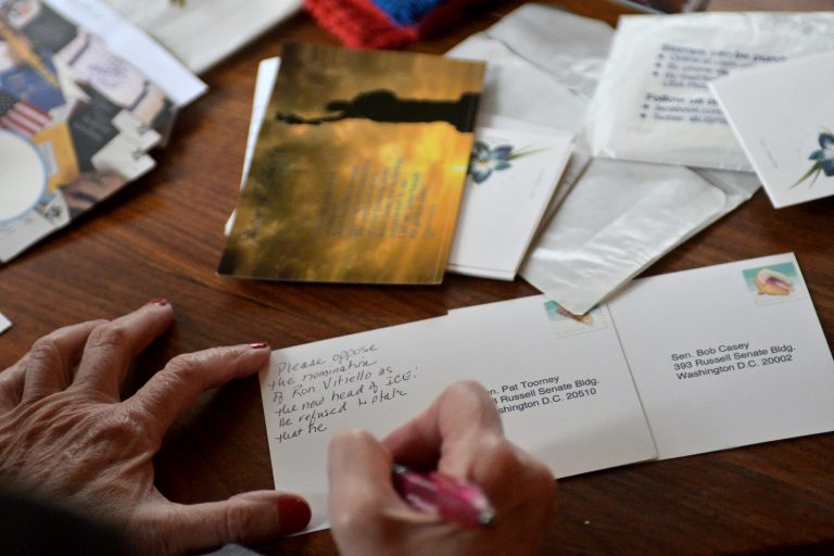 Postcards addressed to Pa. senators Pat Toomey and Bob Casey are written by an activist postcard writer, at a Mt Airy home (Bastiaan Slabbers for WHYY)