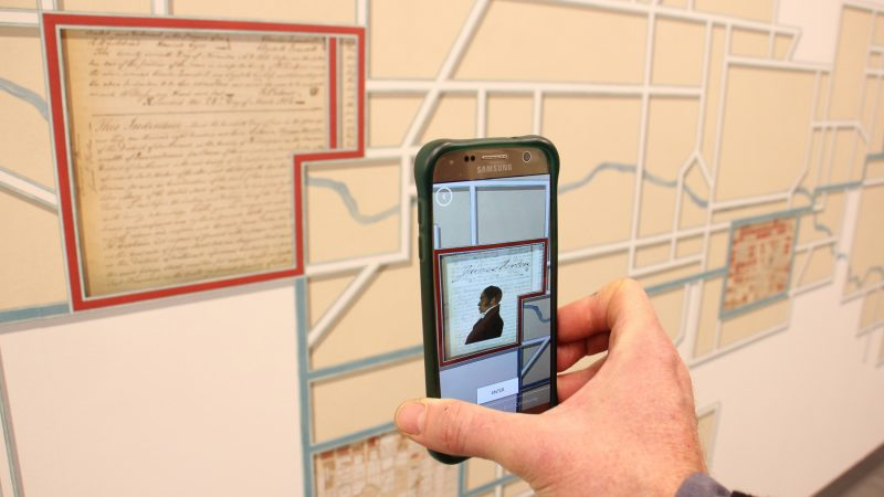 The City Archives mural is enhanced by an augmented reality app, which supplements the experience with illustrations, animations and information. (Emma Lee/WHYY)