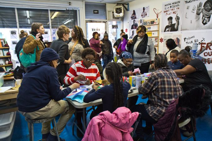 The Village of Arts and Humanities hosted a winter party where community members were invited to create holiday cards to send to Governor Wolf asking him to end a DOC policy that doesn't allow families to send cards of photos to incarcerated family members. (Kimberly Paynter/WHYY)