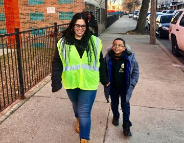 Dalia Burgos and her son Albert walk to Lewis Elkin School in Kensington. (Emma Lee/WHYY)