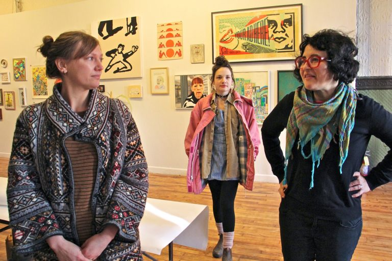 Artists from Space 1026, (from left) Jacqueline Quinn, Rachel Gordon and Miriam Singer, prepare for the collective's final auction at 1026 Arch Street in Chinatown. A steep rent increase has driven them to seek space elsewhere.
