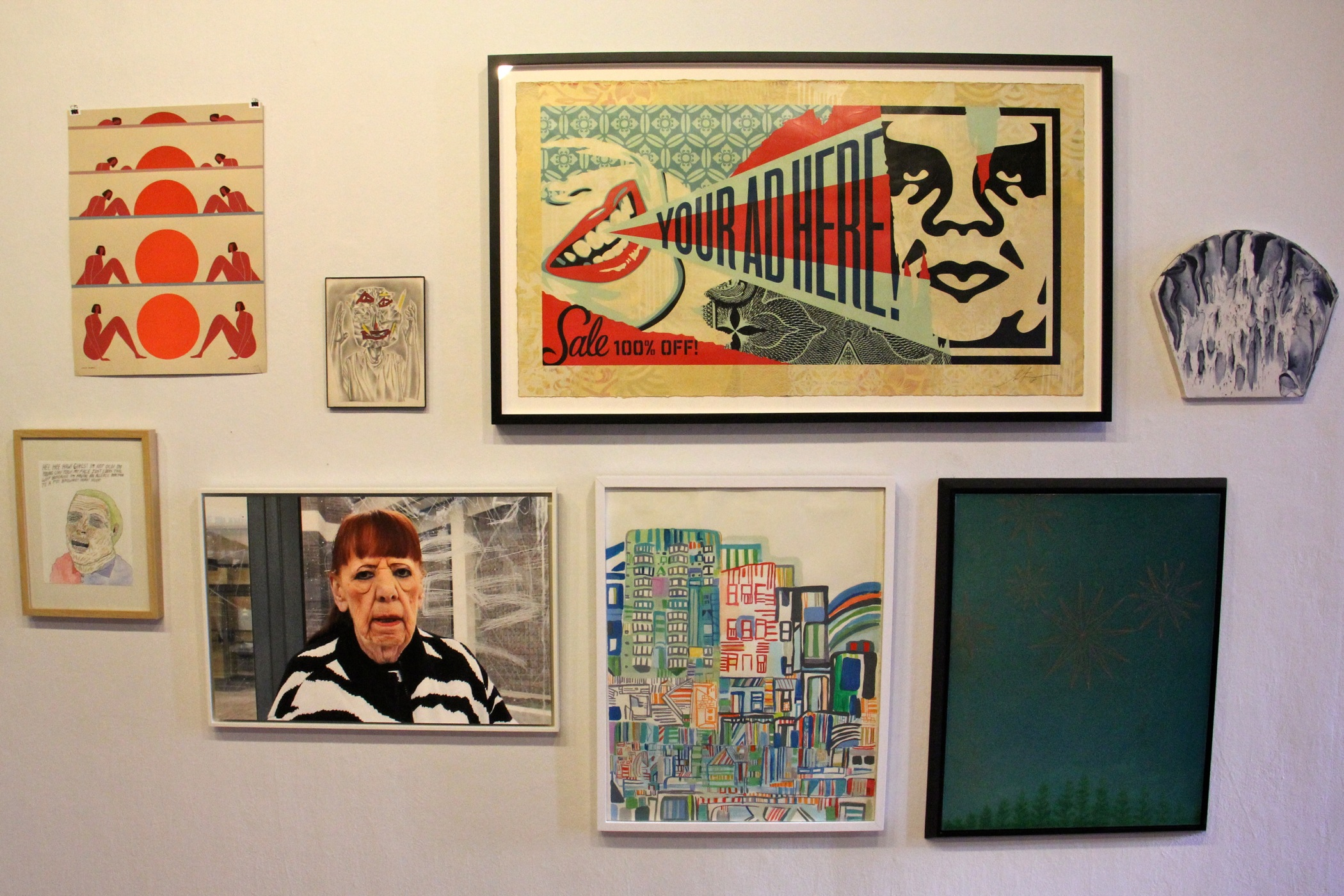 A photograph by Zoe Strauss (lower left) and a print by Shepard Fairey (upper right), which is expected to bring $11,000, are among the works to be auctioned for the benefit of Space 1026.