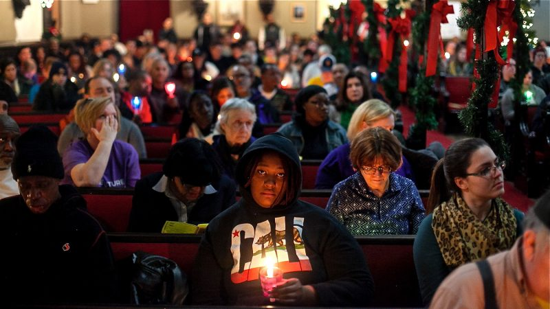 Philadelphians, some formerly and currently homeless, attended a Homeless Memorial Day service at Arch Street United Methodist Church Thursday evening. (Brad Larrison for WHYY)