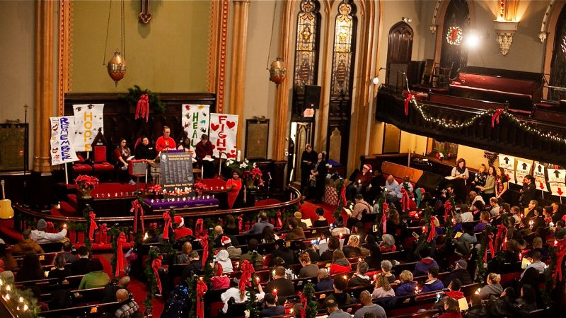 Hundreds of Philadelphians, some formerly and currently homeless, attend a Homeless Memorial Day service at Arch Street United Methodist Church Thursday evening. (Brad Larrison for WHYY)