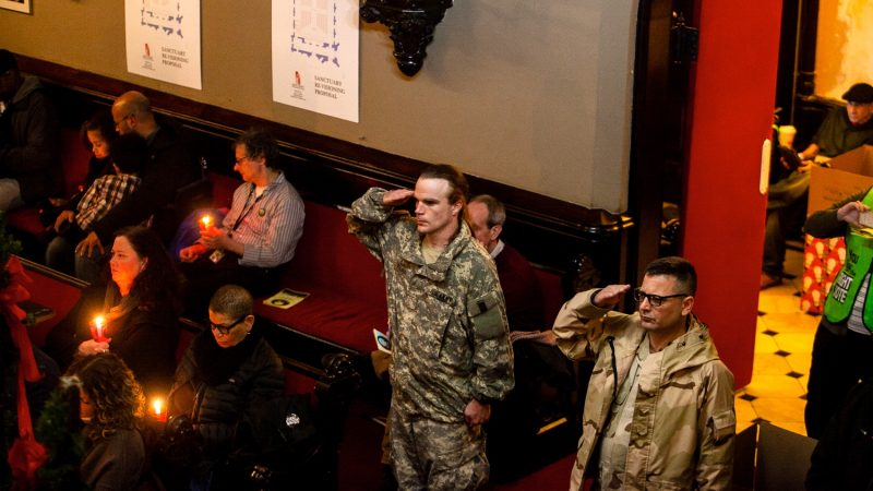 The names of 270 homeless Philadelphians, many of them veterans, who died in the past year are read at a Homeless Memorial Day service at Arch Street United Methodist Church Thursday evening. (Brad Larrison for WHYY)