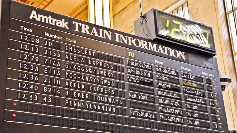 The flip-board sign at 30th Street is the last of its kind still in service at an Amtrak station (Kimberly Paynter/WHYY)