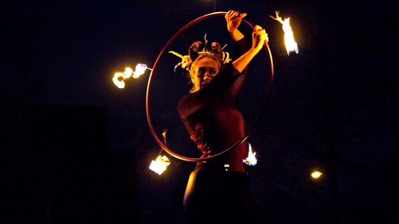 A fire dancer performs the 2018 Parade of Spirits. (Kimberly Paynter/WHYY)