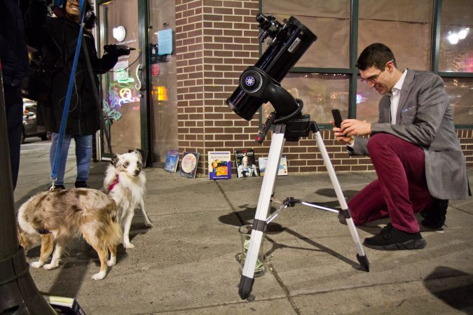 Brendan Happe photographs dogs at 4th and South Streets. (Kimberly Paynter/WHYY)