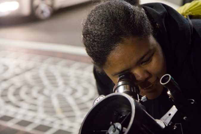 The Philadelphia Moon Men invite people on the streets of Philadelphia to gaze at the moon. (Kimberly Paynter/WHYY)