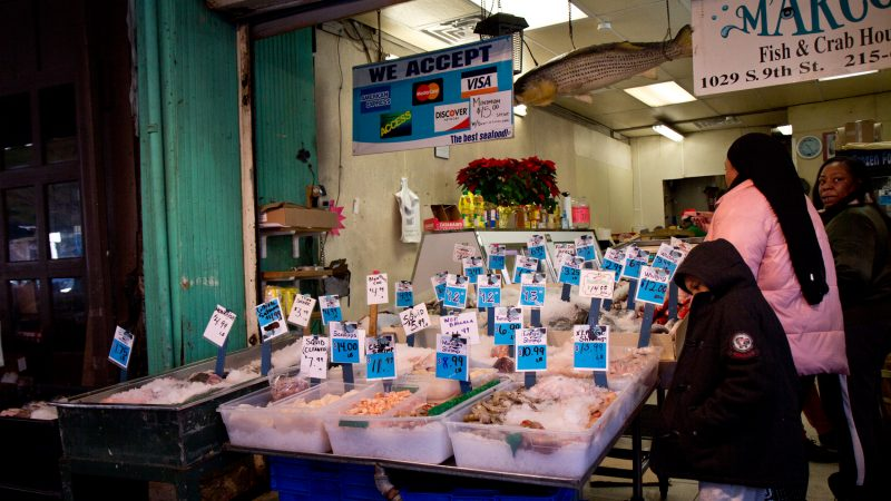 Tracey Prioleau and her family shop for Christmas fish at Marcos in the Italian Market. (Kimberly Paynter/WHYY)