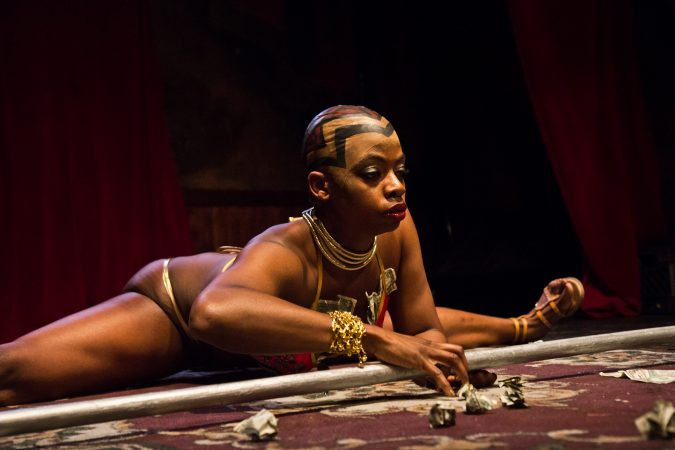 Renaissance Noir performs in the Black Panther Burlesque show at The Trocadero on Friday, May 11, 2018. Noier, who produced the show, was inspired by the general character, Okoye, who led the Wakandan armed forces in the movie. (Kimberly Paynter/WHYY)