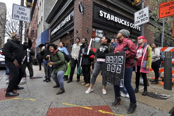 Protesters gather at the Starbucks near Rittenhouse square on  April 16, 2018, to protest the recent arrest of two black men who refused to make a purchase or leave.  (Bastiaan Slabbers for WHYY)